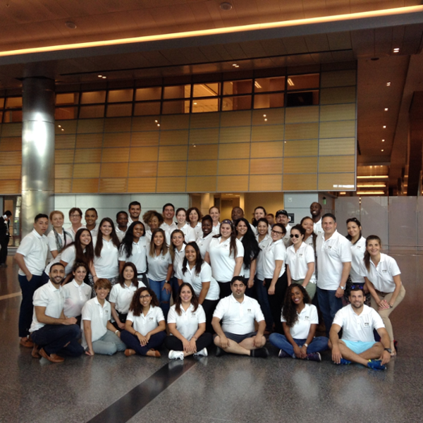 Group Photo of Students in white Polos